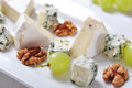 Camembert and blue cheese on plate with grape walnut closeup Stock Photography