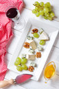 Camembert and blue cheese on plate with grape walnut top view Royalty Free Stock Images