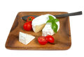 Camembert cheese and fresh cherry tomatoes wooden plate with white closeup Royalty Free Stock Image