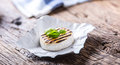 Camembert cheese. Grilled camembert cheese with olive oil and basil leaves Royalty Free Stock Photo
