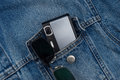 Camera in a jeans pocket Royalty Free Stock Photo