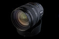 Camera lens on a black background Royalty Free Stock Photos