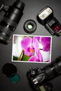 Camera lens and image on black background lense showing photographer still life Stock Photography