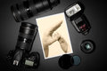Camera lens and image on black background lense showing photographer still life Royalty Free Stock Image