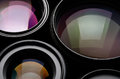 Camera lens set of different sizes and colors Royalty Free Stock Photos