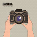 Camera person holding a over beige background vector illustration Stock Photo