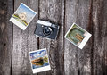 Camera and photos of india old film polaroid with indian famous landmarks on the wooden background Stock Images
