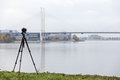 Camera for timelapse shooting on professional tripod on the bridge background Royalty Free Stock Photo
