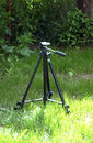 Camera tripod in a grass picture of Stock Image