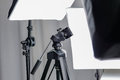 Camera tripod in a photo studio with lightning equipment Royalty Free Stock Photo