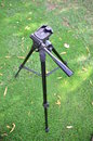 Camera tripod set in the green grass lawn Royalty Free Stock Photography