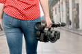 Camera woman holding his professional camcorder in the street Royalty Free Stock Photo