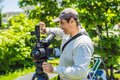 Cameraman, director and asistant on a cinema, commercial production exterior set Royalty Free Stock Photo