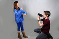 Cameraman little films his singing and dancing sister Royalty Free Stock Photography