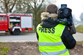 Cameraman press in front of firetruck Royalty Free Stock Image