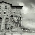 Camouflaged artistic surreal imagine in black and white with a girl face in a complex of antique building and ruins in a surreal Royalty Free Stock Image