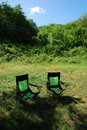 Camp chairs on the lawn Royalty Free Stock Image