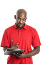 Camp director summer black man in his s writing on a clipboard isolated on a white background Royalty Free Stock Photos