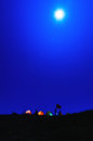 Camp under the moonlight high on top of camping ground tents and moon shine Royalty Free Stock Photo