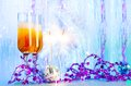 Campaign on new year eve two glasses with filled with alcohol with festive christmas decoration and burning sparklers with sparks Royalty Free Stock Photo