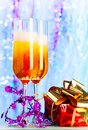 Campaign and present two glasses with filled with alcohol with festive christmas decoration red small with gold ribbon Royalty Free Stock Photos