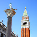Campanile and statue of st theodore on san marco square venice italy Stock Images