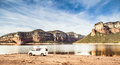 Camped motorhome in natural reservoir of sau lake osona Stock Photo