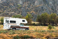 Camper motor home in rugged arid setting copy space Royalty Free Stock Photo