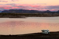 Camper Parked on Lake Pleasant Shoreline Royalty Free Stock Photo