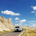 Camper on scenic road. Royalty Free Stock Image