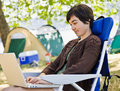 Camper using laptop Stock Photos