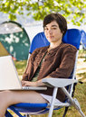 Camper using laptop Royalty Free Stock Photos
