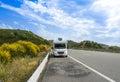 Camper van on the highway caravan car mountain road Stock Image