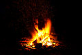 Campfire as a symbol of warmth and life on black abstract burning up firewood dark background Stock Photo