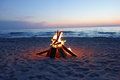 Campfire on the beach inviting in summer Royalty Free Stock Photos