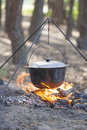 Campfire cooking camping kettle over burning Stock Image