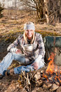 Campfire hiking woman with backpack cook Royalty Free Stock Image