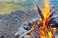 Campfire a hot burns next to a river Stock Image