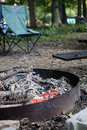 Campfire in metal fire ring with embers Stock Image