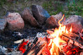A campfire with a ring of stones around it Royalty Free Stock Photo
