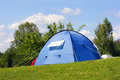Camping blue tent in sunny summer day Stock Photo