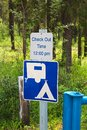 A camping check out time 12:00 pm message sign Royalty Free Stock Photo