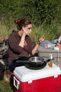 Camping and cosmetics a young woman applies on a trip Royalty Free Stock Photography