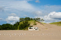 Camping at the dunes a camper parks in warren state park for a fun summer day Stock Photo