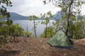 Camping by a lake tent set up beside the beautiful lugu in yunnan province china Royalty Free Stock Image