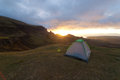 Camping on a mountain ridge small hiking tent built grassy photo taken the isle of skye near the quiraing Royalty Free Stock Images
