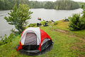 Camping site by a wilderness lake Stock Photos