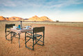 Camping table and chairs in the desert. Great view. Sunrise. Royalty Free Stock Photo