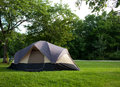 Camping tent at campground during daytime in woods Stock Image
