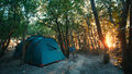 Camping tent in forest with sunlight. Traveling Destination Camping Concept